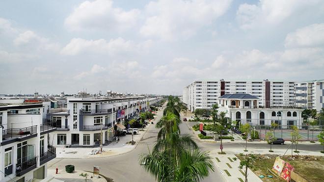 Các khu đô thị tại H.Đức Hòa (Long An) có thể thu hút dân TP.HCM Ảnh: Đình Sơn